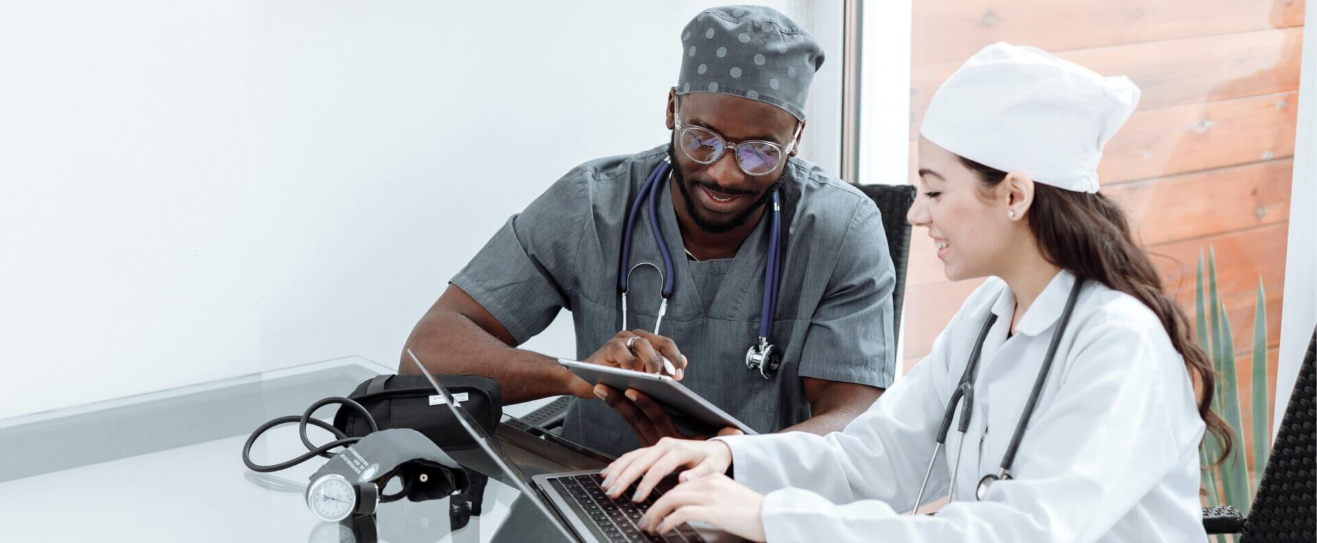 doctors discussing patient information displayed on tablet
